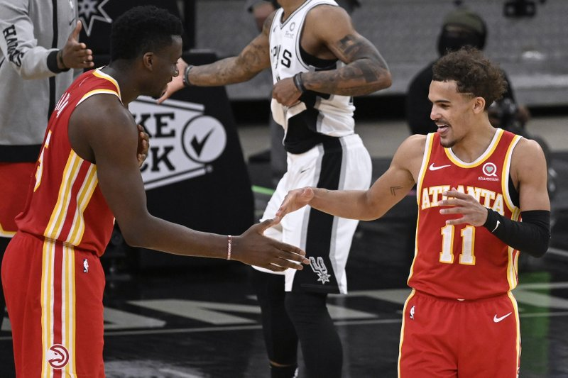 Capela, Young guide Hawks past Spurs 134-129 in 2 OT